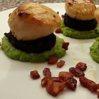 Pan Fried Scallops with Black Pudding, Pea Purée, Pancetta & White Truffle Oil